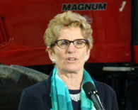 Ontario premier-designate Kathleen Wynne visits a Bradford, Ontario, farm on Feb. 6, 2013 to visit with agriculture stakeholders. (Antonella Artuso/QMI Agency)